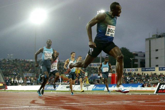 Les 19 sec 79/100 d'Usain Bolt sur le... (Photo : AFP)