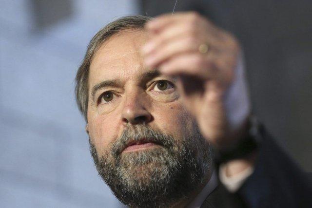 Thomas Mulcair, le chef du NPD.... (PHOTO CHRIS WATTIE, REUTERS)