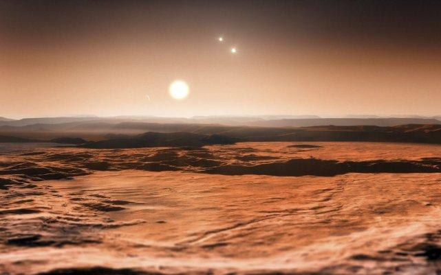 Vue de la planète Gliese 667C et de... (Photo M. KORNMESSER, AFP)