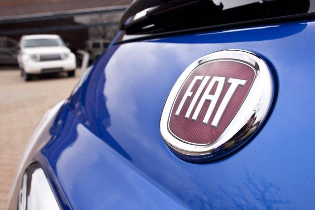 Fiat avait pris en 2009 le contrôle opérationnel... (Photo Geoff Robins, archives AFP)
