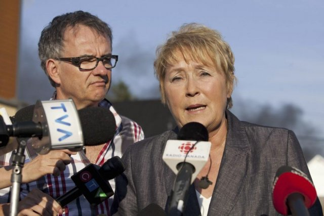 Réjean Hébert et Pauline Marois lors d'un point... (Photo La Presse Canadienne)