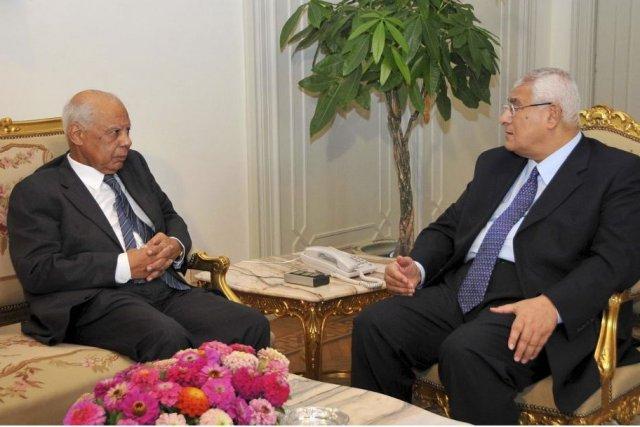 Le premier ministre désigné Hazem Beblawi et le... (Photo Reuters)
