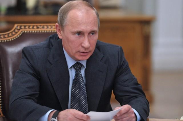 Vladimir Poutine, le président de la Russie.... (PHOTO ALEXEI NIKOLSKY, RIA NOVOSTI, AP)