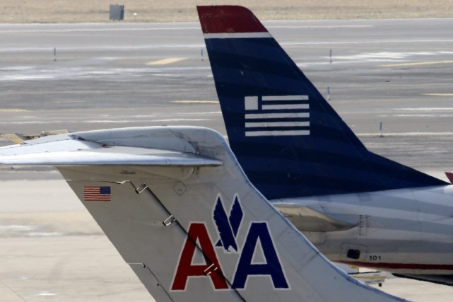 AmericanAirlineset US Airways sont en concurrence directe sur... (Photo Matt Rourke, AP)