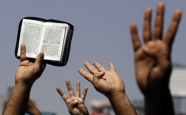 Le Coran contient des versets contradictoires, provenant de deux époques de la... (Photo Amr Abdallah Dalsh, Reuters)