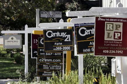 Sur un an, les reventes de maisons et... (Photo archives Associated Press)
