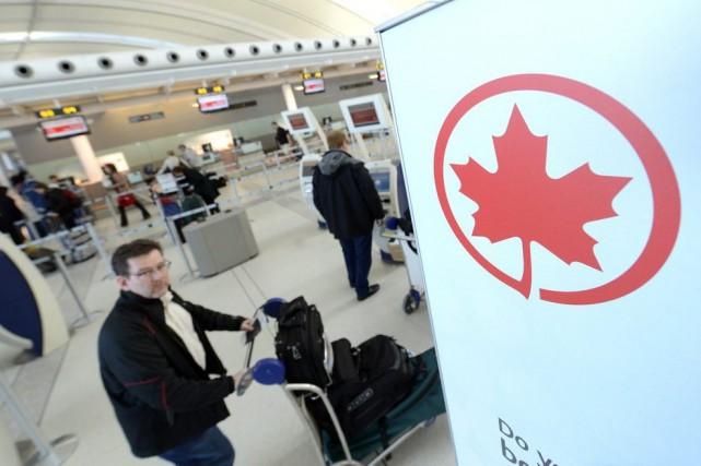 Les avions d'Air Canada (T.ac.b) comptaient moins de sièges... (Photo Aaron Harris, Bloomberg)