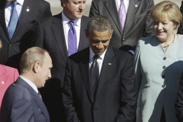 Les présidents Vladimir Poutine et Barack Obama lors... (Pablo Martinez Monsivais)
