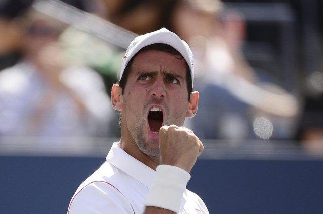 Novak Djokovic a défait Stanislas Wawrinka en cinq... (PHOTO EMMANUEL DUNAND, AFP)