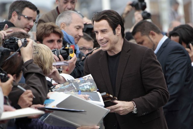 John Travolta a fait sensation vendredi, sur le tapis... (Photo CHARLY TRIBALLEAU, AFP)