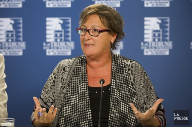 Lucie Martineau, présidente de la SFPQ, salue la... (PHOTO IVANOH DEMERS, LA PRESSE)