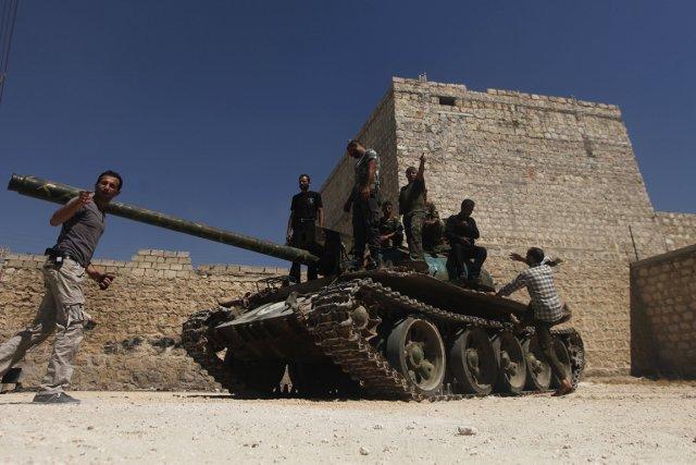Des membres de la brigade Liwaa Ahrar Suriya,... (Photo Hamid Khatib, Reuters)