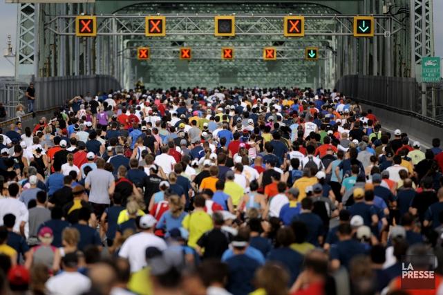 On s'attend à ce que 20 000 coureurs... (Photo Bernard Brault, archives La Presse)