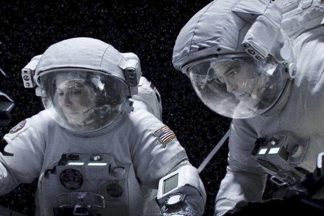 Sandra Bullock et George Clooney dans Gravity.... (Photo fournie par Warner Bros.)