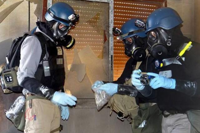 Des inspecteurs de l'ONU enquêtant sur la présence... (AP)