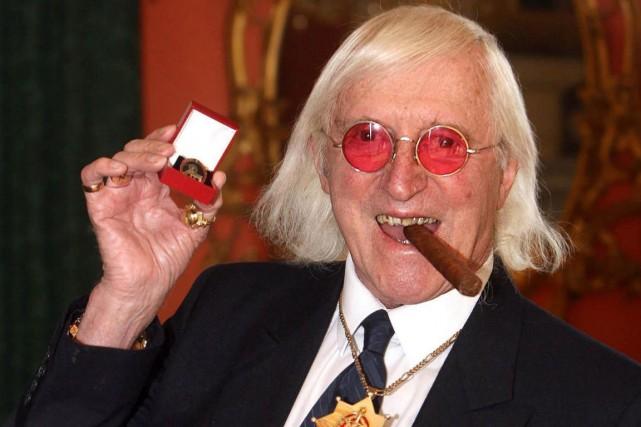 L'ex-animateur de la BBC Jimmy Savile, décédé en... (PHOTO LEWIS WHYLD, ARCHIVES AP)
