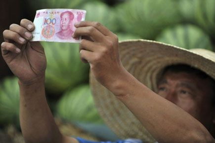 Le renminbi, ou «monnaie du peuple», autre nom... (Photo Sheng Li, archives Reuters)