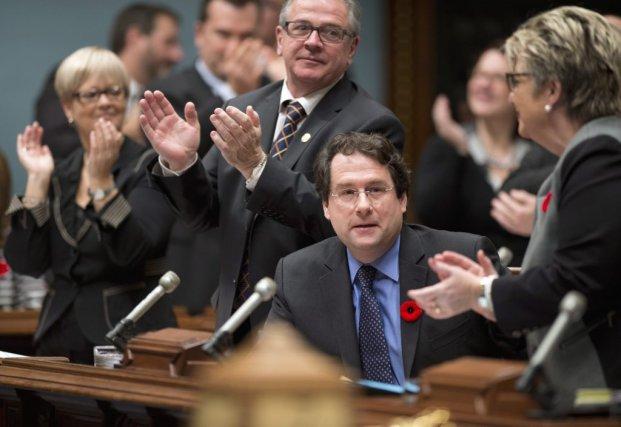 Le projet controversé de laïcité de l'État, promu... (Photo Jacques Boissinot, La Presse Canadienne)
