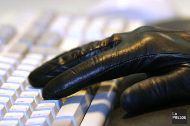 Les attaques envers les entreprises de services financiers... (Photo Archives AFP)