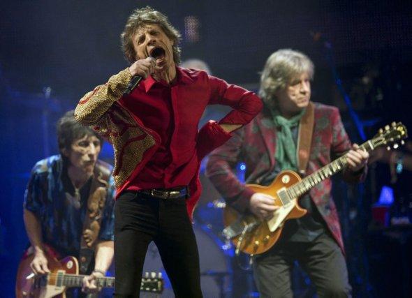 Ronnie Wood, Mick Jagger et Mick Taylor des... (Photo: archives AP)