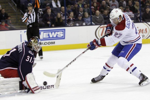 Alex Galchenyuk (27) a marqué contre le gardien... (PHOTO JAY LAPRETE, ASSOCIATED PRESS)