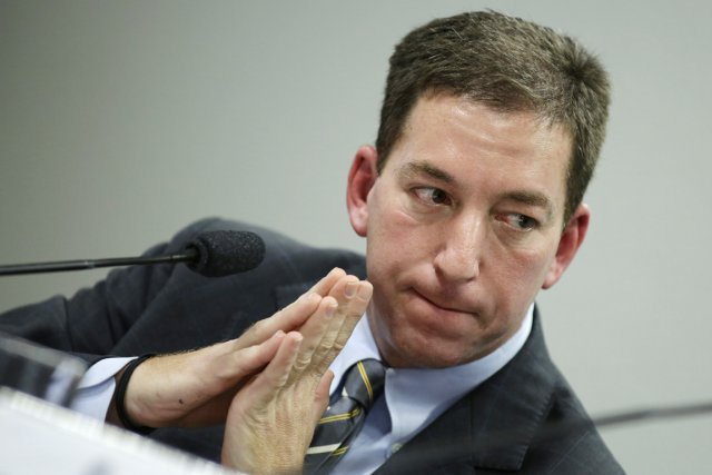 Avocat de formation, Glenn Greenwald avait collaboré au... (PHOTO UESLEI MARCELINO, REUTERS)