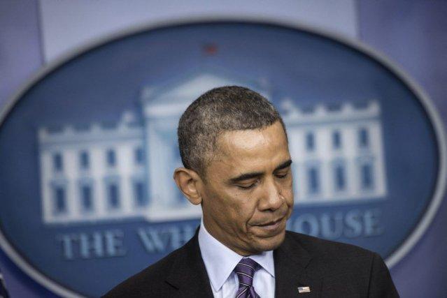 Le président des États-Unis Barack Obama et deux de ses prédécesseurs, George... (Photo AFP)
