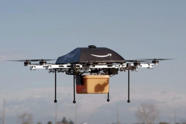 Le géant du commerce en ligne Amazon affirme être en train de tester un système... (Photo AP)