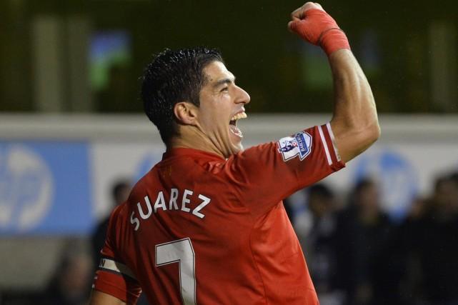 Luis Suarez... (Photo Toby Melville, Reuters)