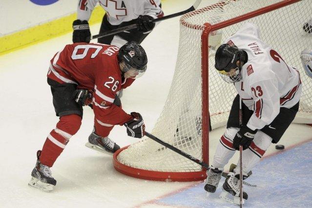 Le Canada est assuré de terminer parmi les... (Photo AFP)