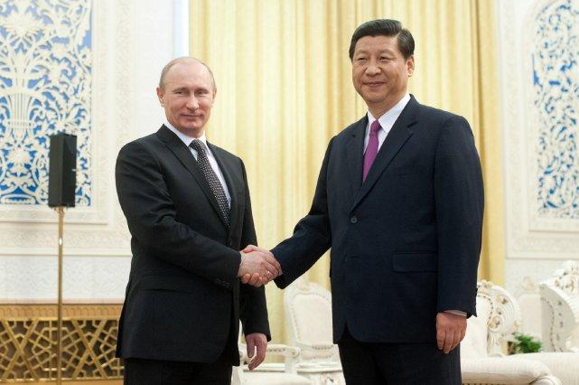 Le président de la Russie, Vladimir Poutine, et... (Photo Ed Jones, archives Agence France-Presse)