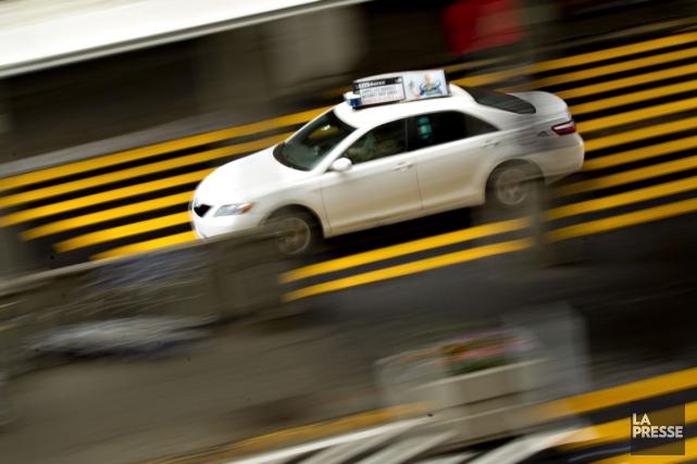 Les applications mobiles lancées cet automne à Montréal secouent le marché... (Photo Olivier Jean, archives La Presse)