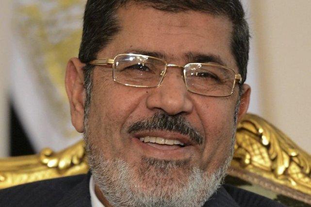 Mohamed Morsi encourt la peine de mort comme... (PHOTO KHALED DESOUKI, AFP)