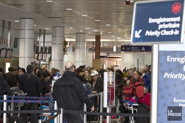 Quelque 70 vols ont été retardés samedi matin.... (PHOTO HUGO-SÉBASTIEN AUBERT, ARCHIVES LA PRESSE)