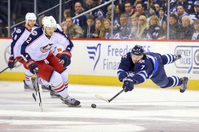 Les Blue Jackets ont inscrit quatre buts consécutifs... (Photo Bruce Fedyck, USA TODAY Sports)
