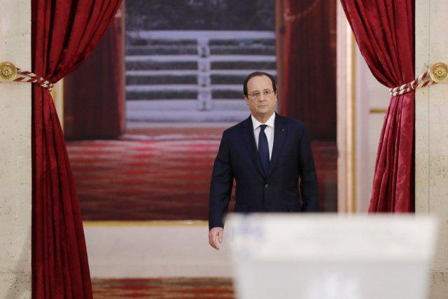 Le président François Hollande arrive à l'Élysée pour... (PHOTO PHILIPPE WOJAZER, REUTERS)