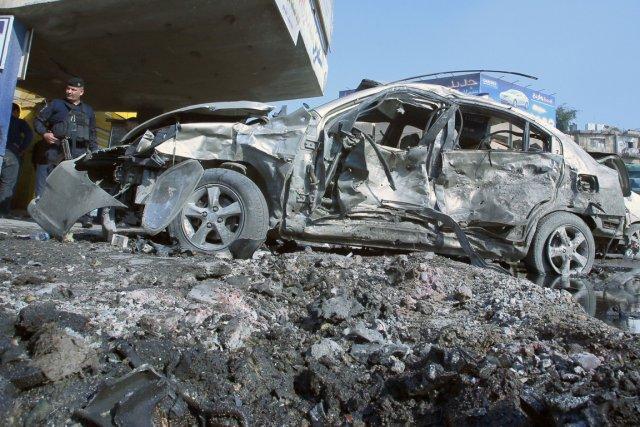 Sept voitures piégées ont explosé à quelques minutes... (PHOTO ALI AL-SAADI, AFP)