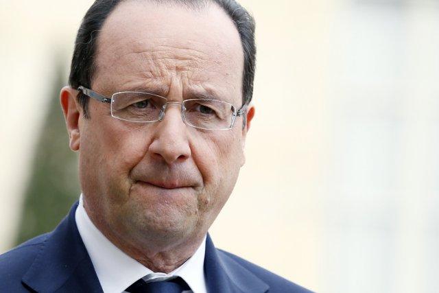 Le président François Hollande a cru que la... (PHOTO PATRICK KOVARIC, AFP)