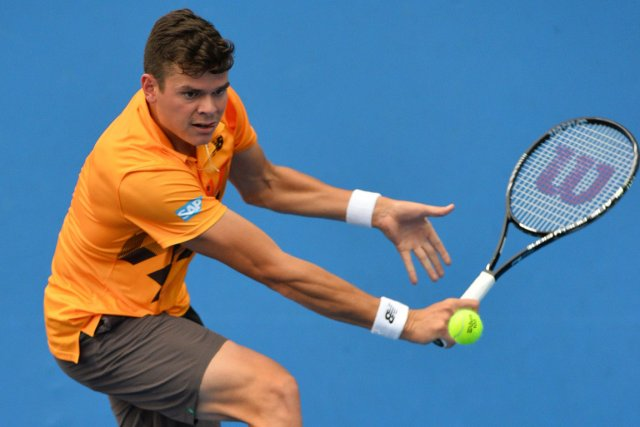 Milos Raonic vaincu le Roumain Victor Hanescu au... (PHOTO SAEED KHAN, AFP)