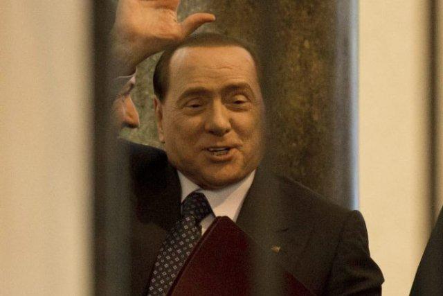 Silvio Berlusconia promis de travailler en faveur de... (Photo Andrew Medichini, AP)