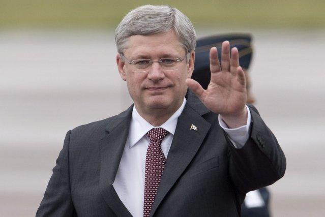 Ce séjour de Harper suit sa triomphale visite... (Photo Adrian Wyld, La Presse Canadienne)