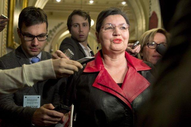La députée libérale Fatima Houda-Pépin a été entourée... (La Presse Canadienne)
