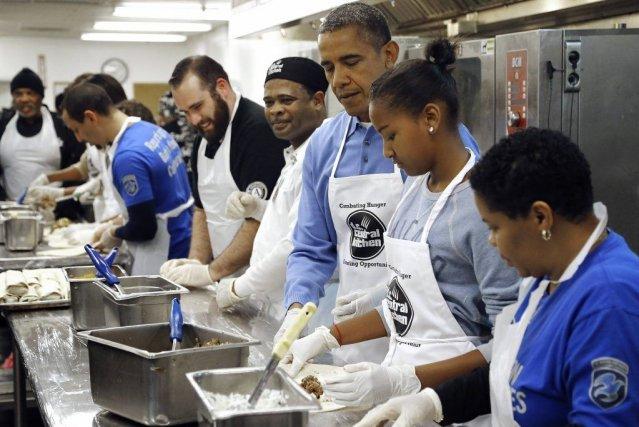 Le président Obama, sa femme et leurs deux... (Photo: Reuters)