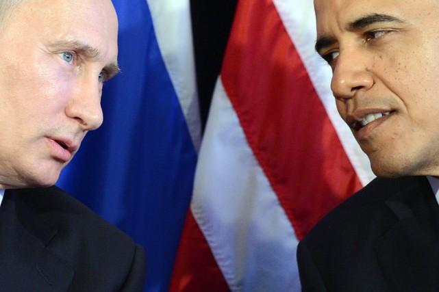 Vladimir Poutine etBarack Obama en marge du sommet... (Photo: AFP)