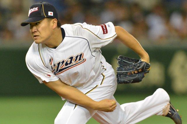 Le lanceur japonais Masahiro Tanaka était convoité par... (Photo Kazuhiro Nogi, AFP)