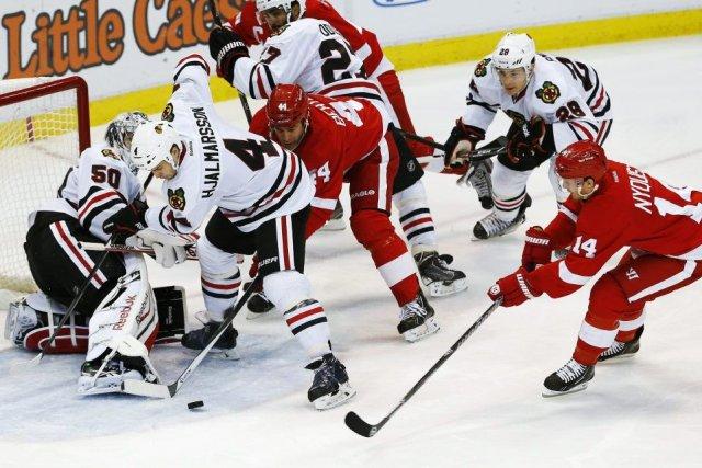 Darren Helm des Red Wings a marqué au sixième tour de la fusillade puis Jonas... (Photo AP)
