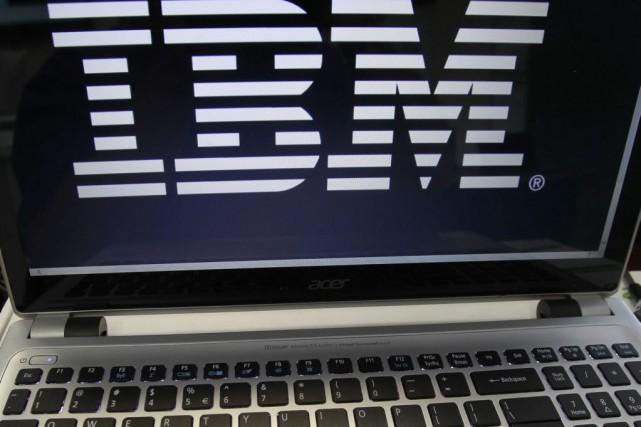 Trois employés de IBM, Patrick Fortin, Gilles Gariépy... (Archives AP)