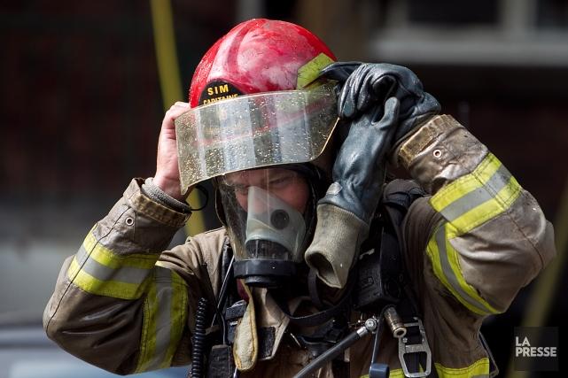 Des travaux d'excavation ont causé une fuite de gaz sur la rue Sainte-Catherine... (PHOTO ARCHIVES LA PRESSE)