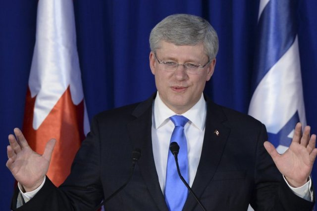 Pendant son séjour, M.Harper a multiplié les oeillades... (PHOTO LA PRESSE CANADIENNE)