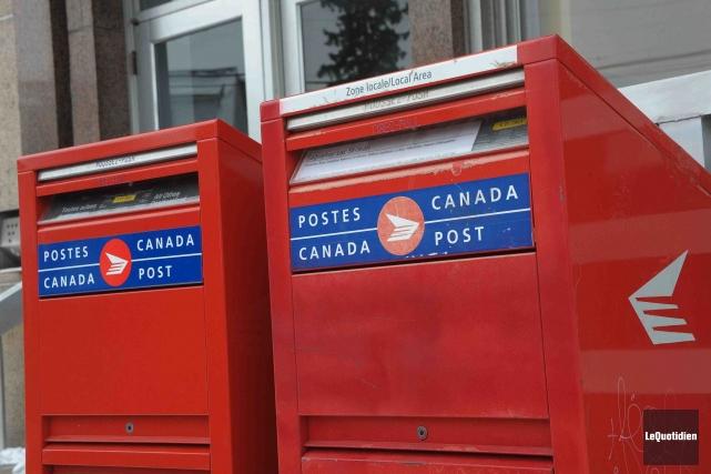 Postes Canada a annoncé lundi avoir abaissé sa perte nette à 29 millions $ l'an... (Photo ARCHIVES Le Quotidien)